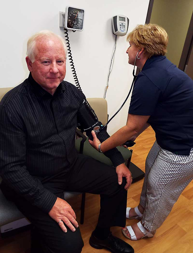 Taking a patient's blood pressure
